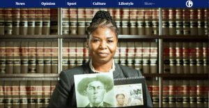 a black woman with old photos standing in front of books